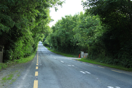 the backplate: Countryside road in Ireland Stock Photo