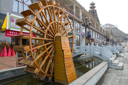 tourism  city: Water wheel in the Guizhou colorful Vientiane Tourism City Editorial