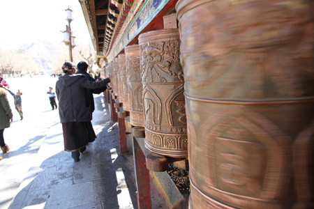 potala: Tibetan prayer wheel, the back of the Potala Palace