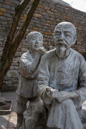 China's Guizhou Province, Anshun, Pingba County Tianlongtunbao area, children and senior citizens statue
