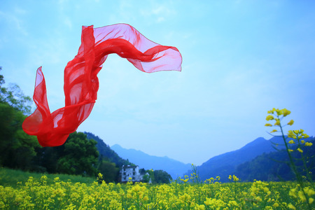 Red scarf blown by the wind