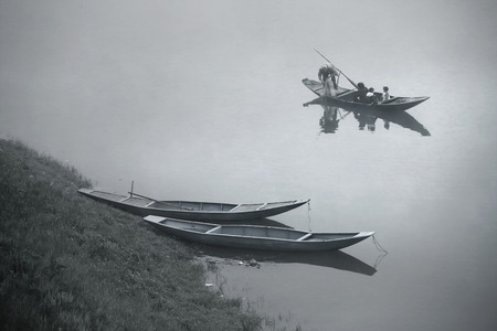 chinese fishing nets: Family fishing on a wooden boat