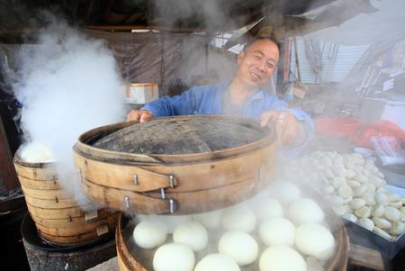 Steamed bun seller at street market