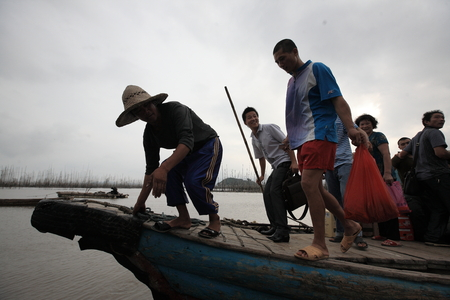disembark: People coming down from a fishing boat Editorial