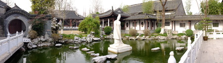 chinese courtyard: Traditional chinese architecture with a statue