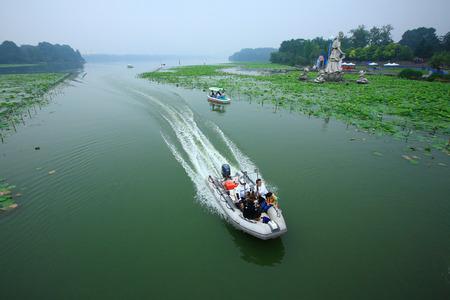 motor boat: A motor boat speeding through a lake