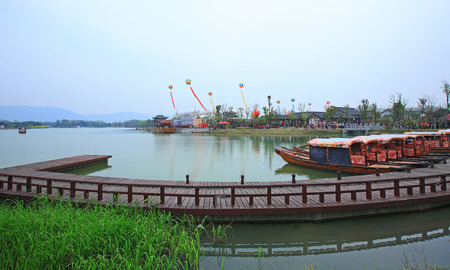 boat dock: View of the flower festival ceremony from a boat dock