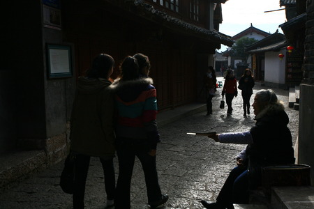 reaching out: Woman reaching out to tourists
