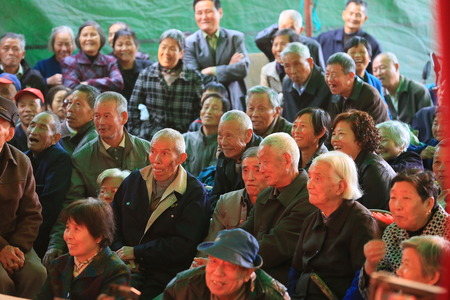 only senior men: Audiences watching a chinese opera