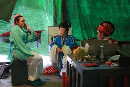 chinese opera: Chinese opera performers taking a break backstage