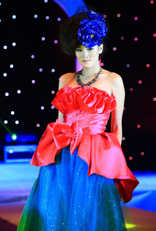 one mature woman only: Fashion model in ball gown walking down the runway Editorial