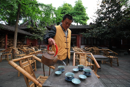 one mature man only: Man pouring tea