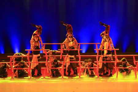 stage costume: Men dressed in traditional martial arts costume performing on stage