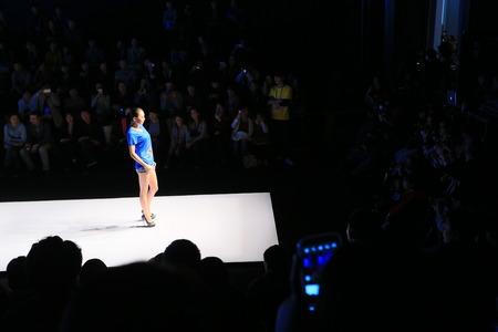 catwalk model: A model standing on catwalk runway Editorial
