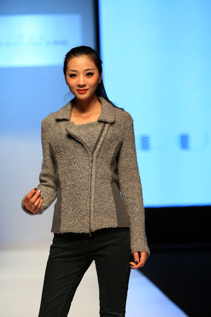 catwalk model: A model posing on catwalk runway Editorial