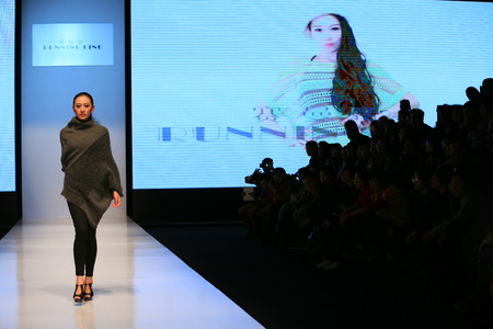 catwalk model: A model walking on catwalk runway Editorial