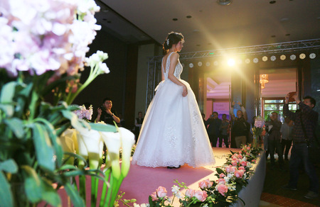 bridal gown: A woman in bridal gown walking on a runway