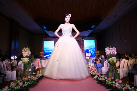 bridal gown: A woman in bridal gown walking on runway