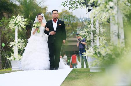bridegroom: Bride and bridegroom walking together