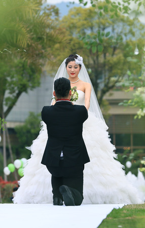 only two people: Bridegroom giving his bride a bouquet of flowers