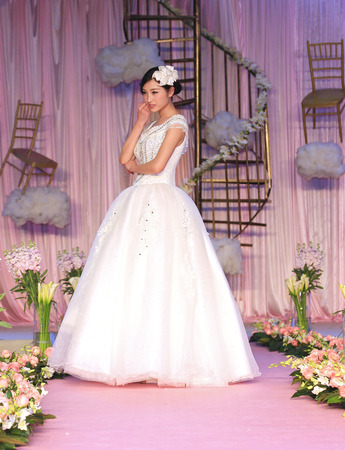 bridal gown: A woman with bridal gown posing