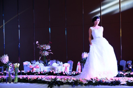 bridal gown: A woman in bridal gown posing Editorial