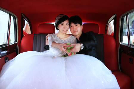 bridegroom: Bridegroom and bride forming heart shape with fingers