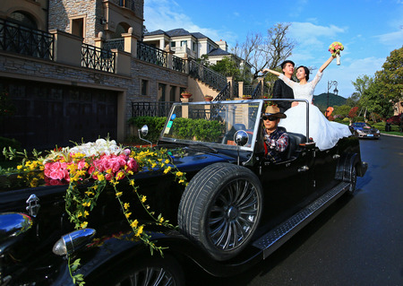 only 3 people: Newlyweds in wedding car