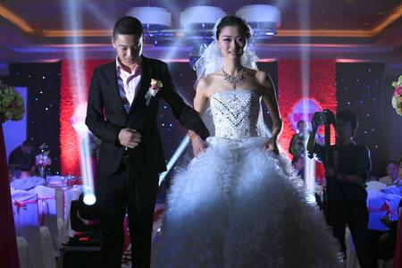 bridegroom: Bridegroom and bride walking Editorial