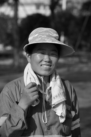one mature woman only: Portrait of a woman worker Editorial