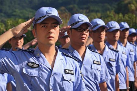 saluting: Young men officers saluting