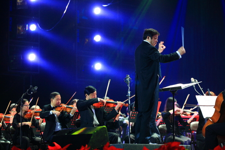 conducting: Conductor conducting orchestra