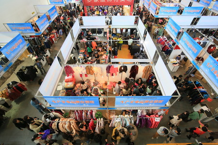 trade show: Crowd in clothing trade show Editorial