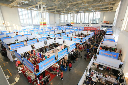 trade show: People visiting clothing trade show Editorial