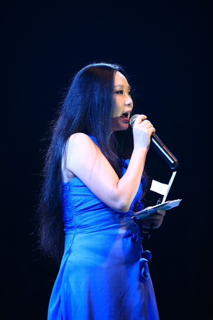 one mature woman only: Woman announcer on stage