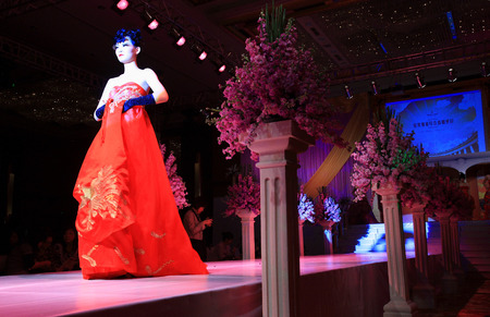 bridal gown: Woman in bridal gown on runway