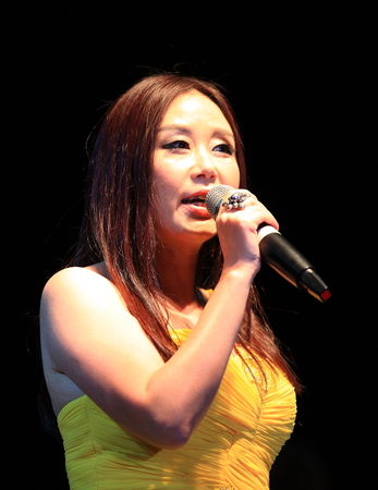 tube top: Woman singing on stage