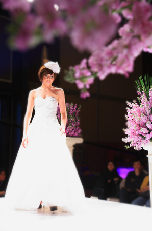 bridal gown: Model with bridal gown on runway