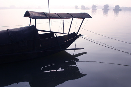 wooden boat: A traditional chinese wooden boat on lake Stock Photo