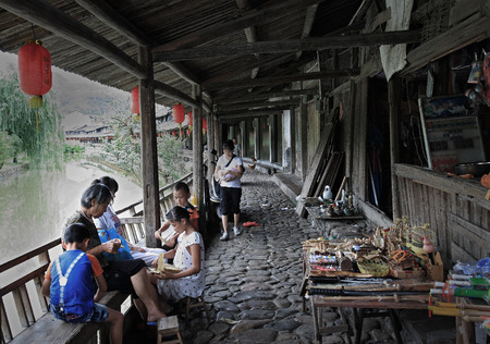villagers: Villagers hand crafting with old papers