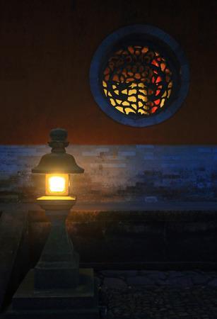 round window: Chinese stone lantern and round window