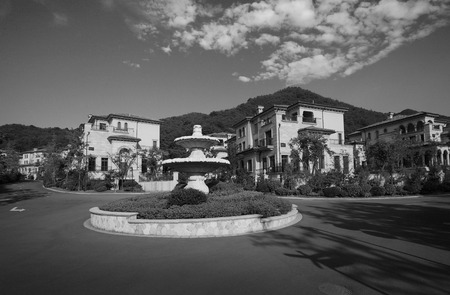 kana: A fountain surrounding by mansions Editorial