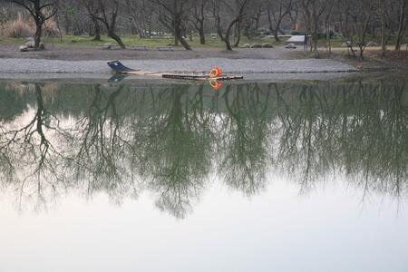 raft: An empty tourist raft near the shore