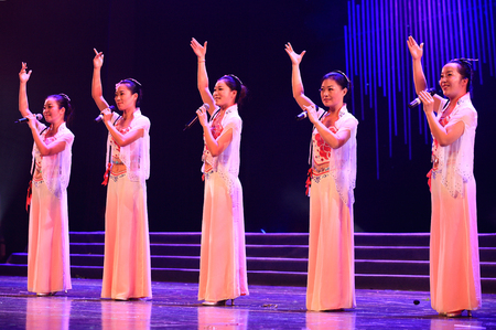 performing: Women performing on stage