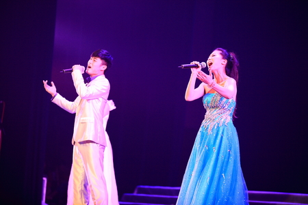 three people only: Two singers performing a duet
