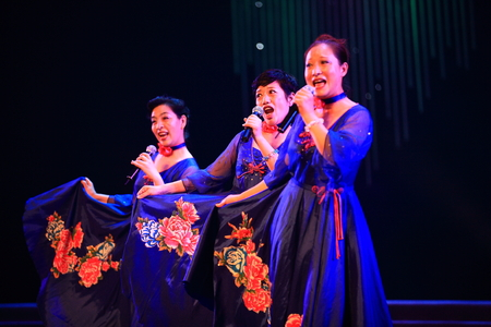 three people only: Group of women singing on stage