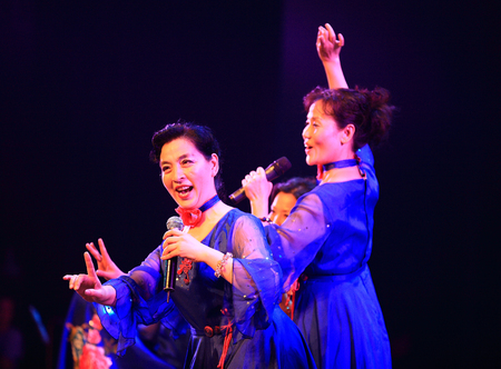 only three people: Group of women singing on stage