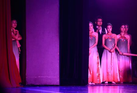 performers: Performers waiting backstage