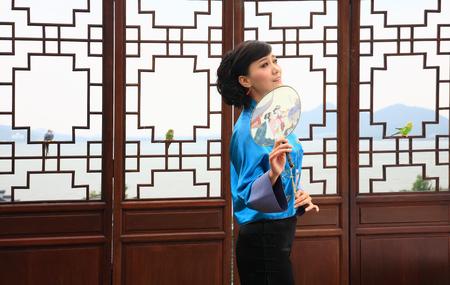 handheld: Woman posing with handheld fan