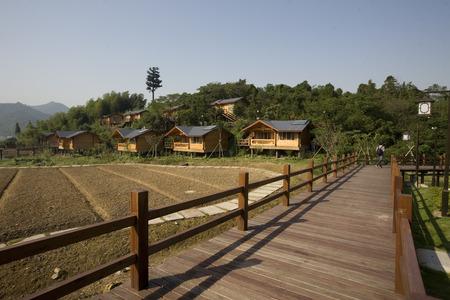 wooden bridge: Village houses with a wooden bridge Editorial
